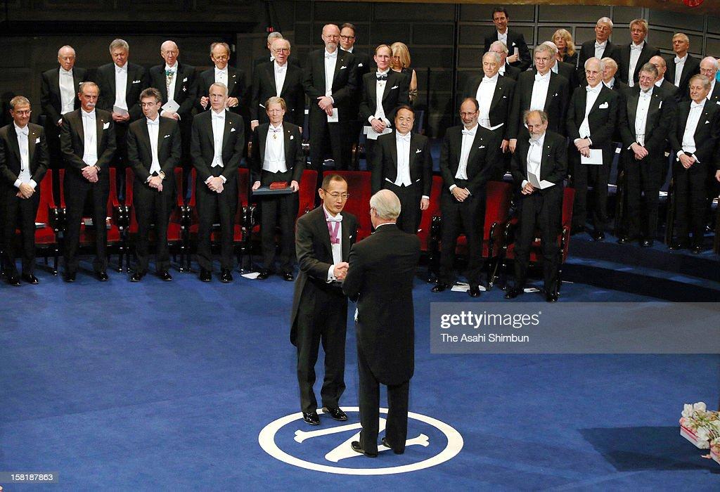Nobel Prize in Medicine laureate Shinya Yamanaka receives the Nobel Prize from King Carl XVI Gustaf of Sweden during the Nobel Prize Award Ceremony...