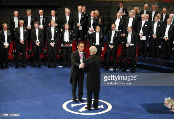 Nobel Prize in Medicine laureate Shinya Yamanaka receives the Nobel Prize from King Carl XVI Gustaf of Sweden during the Nobel Prize Award Ceremony...