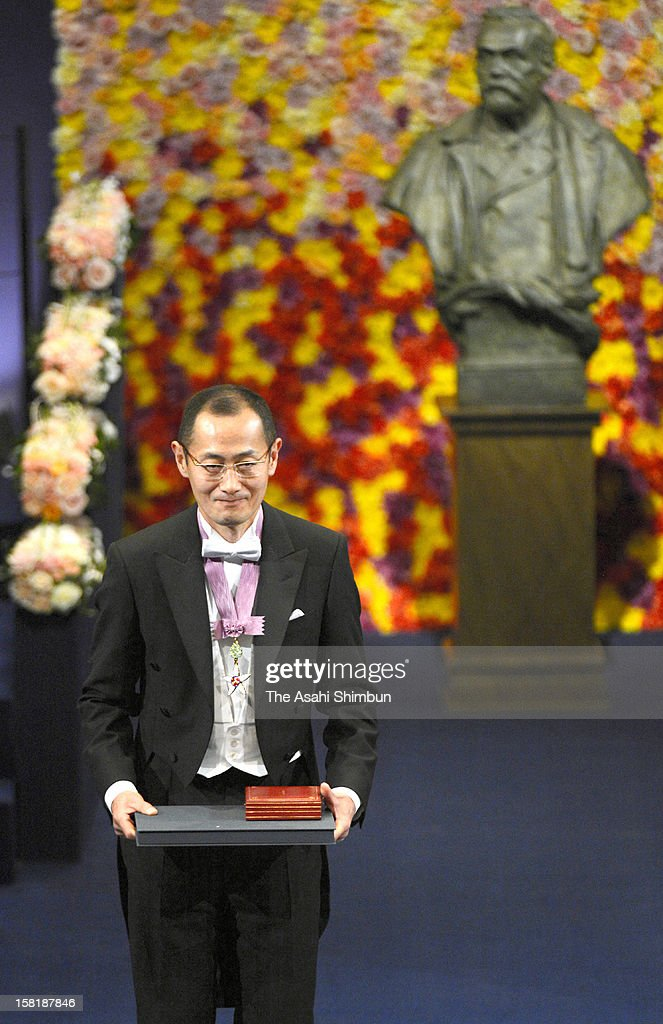 Nobel Prize in Medicine laureate <a gi-track='captionPersonalityLinkClicked' href=/galleries/search?phrase=Shinya+Yamanaka&family=editorial&specificpeople=4810477 ng-click='$event.stopPropagation()'>Shinya Yamanaka</a> smiles after he received the Nobel Prize from King Carl XVI Gustaf of Sweden during the Nobel Prize Award Ceremony at Concert Hall on December 10, 2012 in Stockholm, Sweden.