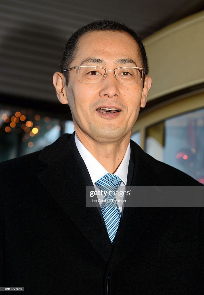 Nobel Prize in Medicine laureate Shinya Yamanaka speaks to the media reporters on departure for the award ceremony rehearsal at a hotel on December 10, 2012 in Stockholm, Sweden.