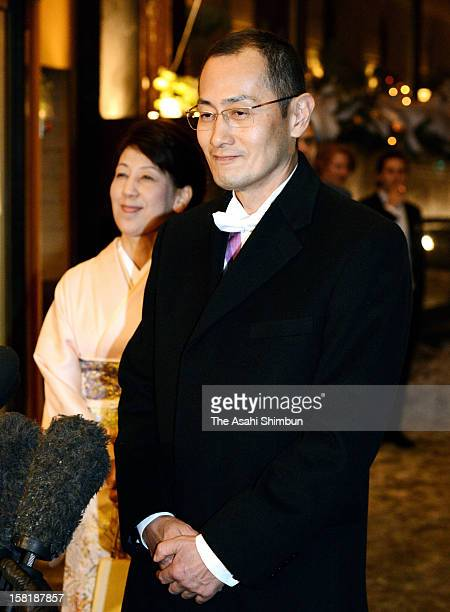 Nobel Prize in Medicine laureate Shinya Yamanaka speaks to the media reporters while his wife Chika listens after attending the Nobel Banquet at Town...