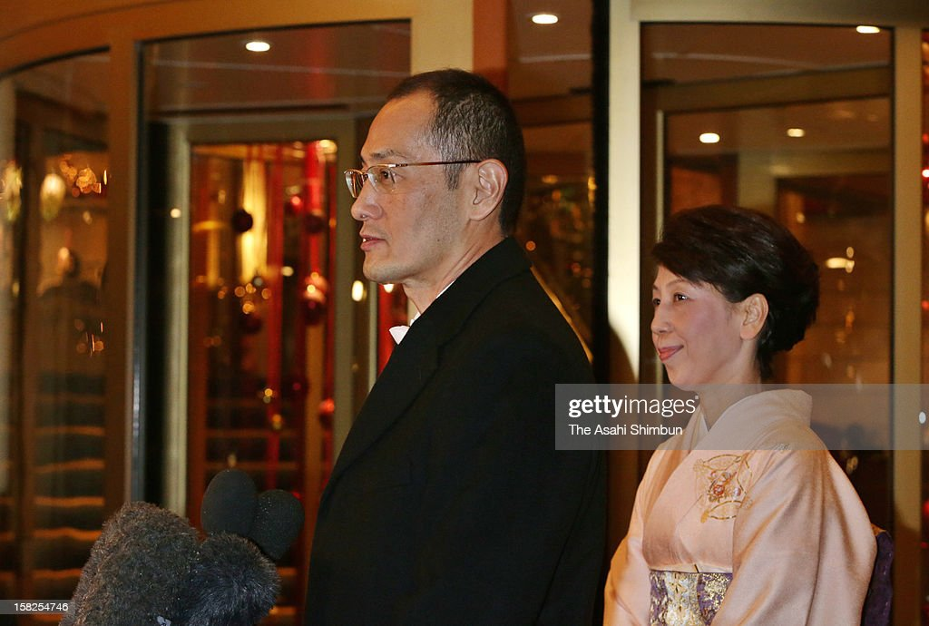 Nobel Prize in Medicine laureate Shinya Yamanaka speaks to the media reporters while his wife Chika listens after attending the Nobel Banquet at Town Hall on December 11, 2012 in Stockholm, Sweden.
