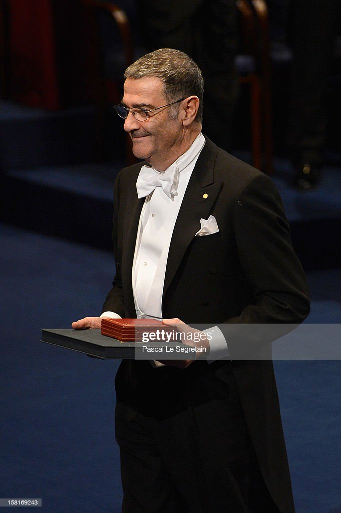 Nobel Prize in Physics laureate Professor <a gi-track='captionPersonalityLinkClicked' href=/galleries/search?phrase=Serge+Haroche&family=editorial&specificpeople=9843166 ng-click='$event.stopPropagation()'>Serge Haroche</a> of France walks back to his seat after he received his Nobel Prize from King Carl XVI Gustaf of Sweden during the Nobel Prize Ceremony at Concert Hall on December 10, 2012 in Stockholm, Sweden.