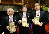 Nobel Prize in Physics winners Isamu Akasaki Hiroshi Amano and Shuji Nakamura display their medals after the Nobel Prize Awards Ceremony at Concert...
