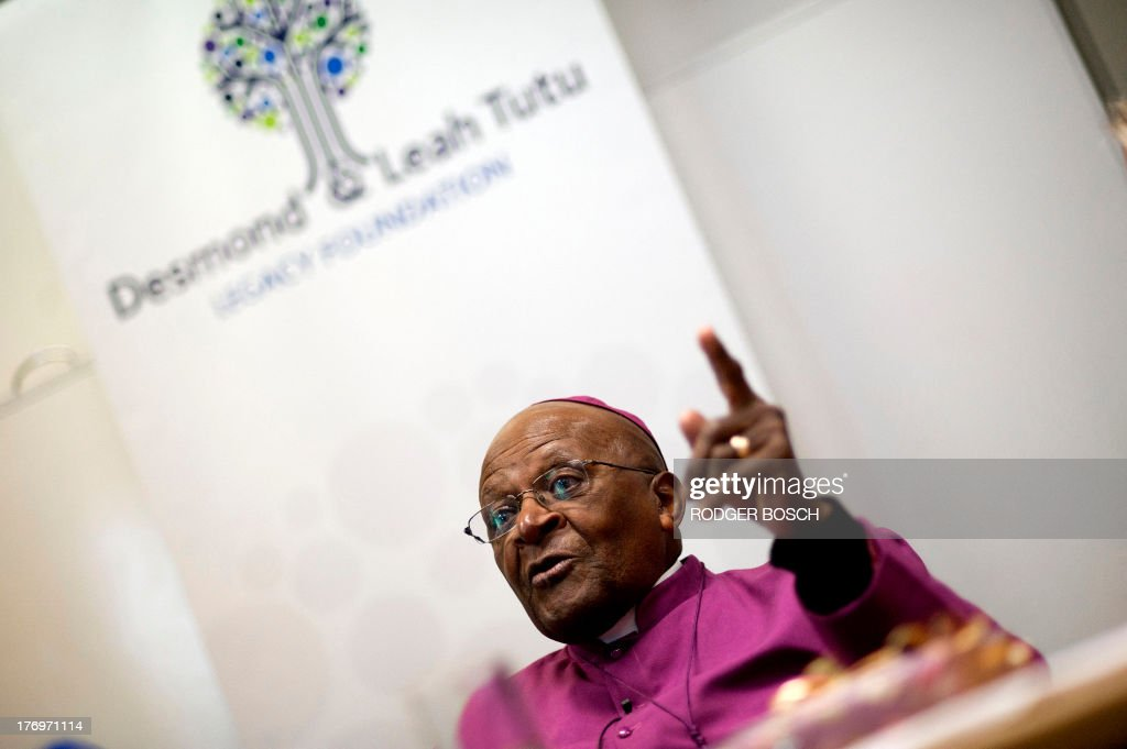 Nobel Prize Peace Laureate Archbishop Desmond Tutu speaks as he attends the launching ceremony of a partnership between his foundation and other organizations at the University of Stellenbosch Medical School, on August 20, 2013, in Bellville, Cape Town. The partnership between the Desmond and Leah Tutu Legacy Foundation, Stellenbosch University, and Gender Reconciliation International will focus on the implementation of gender reconciliation, applying principles of South Africas truth and reconciliation process to restore peoples faith in one another. AFP PHOTO / RODGER BOSCH