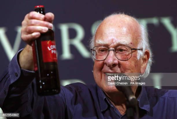 Nobel Prizewinning scientist Professor Peter Higgs receives a bottle of London Pride at a press conference in Edinburgh