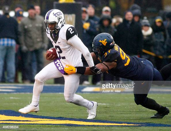 Noble Nwachukwu of the West Virginia Mountaineers attempts to tackle Trevone Boykin of the TCU Horned Frogs in the first half during the game on...