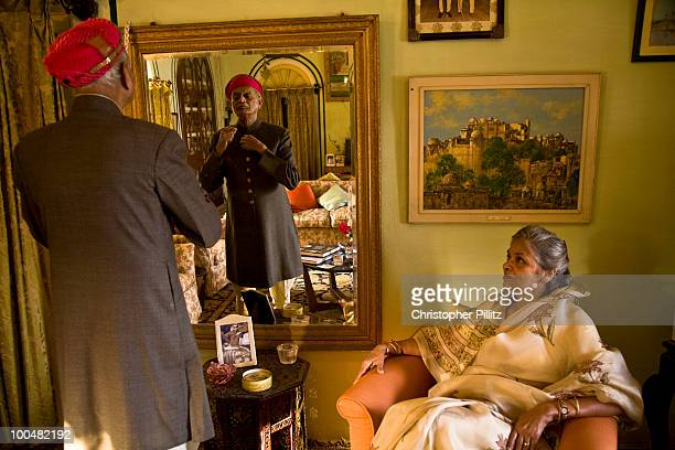 Nobleman dressing into formal dress at home