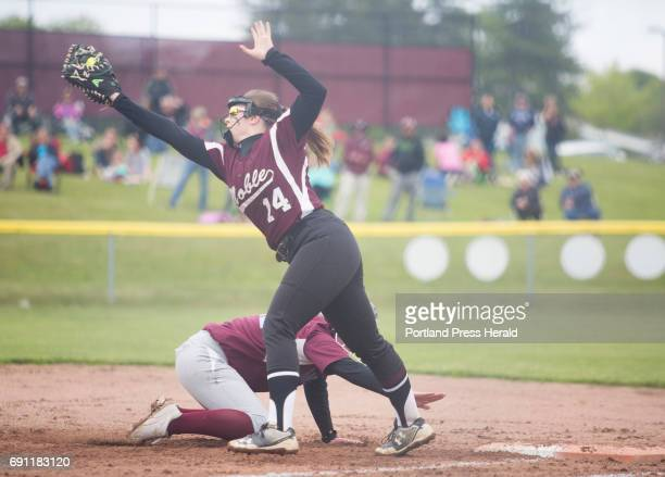 Noble's Jordan Boucher attempts to get Windham's Chloe Wilcox out while leading off first during their game at Windham High School