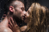 Blurred image of a sexy pair kissing in the shower
