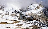 Noboribetsu onsen hell valley and bridge snow winter landscape national park in Jigokudani, Hokkaido, Japan