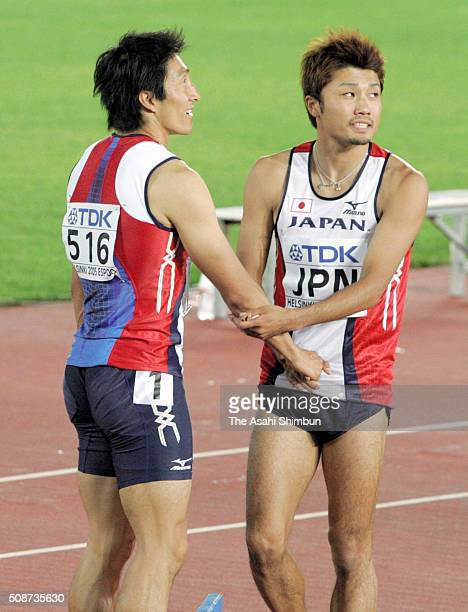 Nobuharu Asahara and Shingo Suetsugu of Japan applaud after competing in the Men's 4x100m Relay final during day nine of the IAAF World Championships...