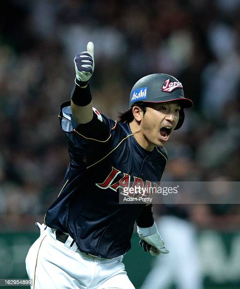 Nobuhiro Matsuda of Japan celebrates after Japan takes the lead over Brazil during the World Baseball Classic First Round Group A game between Brazil...