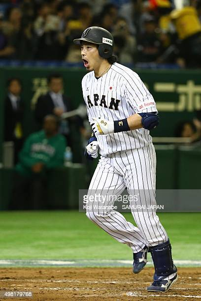 Nobuhiro Matsuda of Japan celebrates as he scores after hitting a tworun homerun in the bottom half of the second inning during the WBSC Premier 12...
