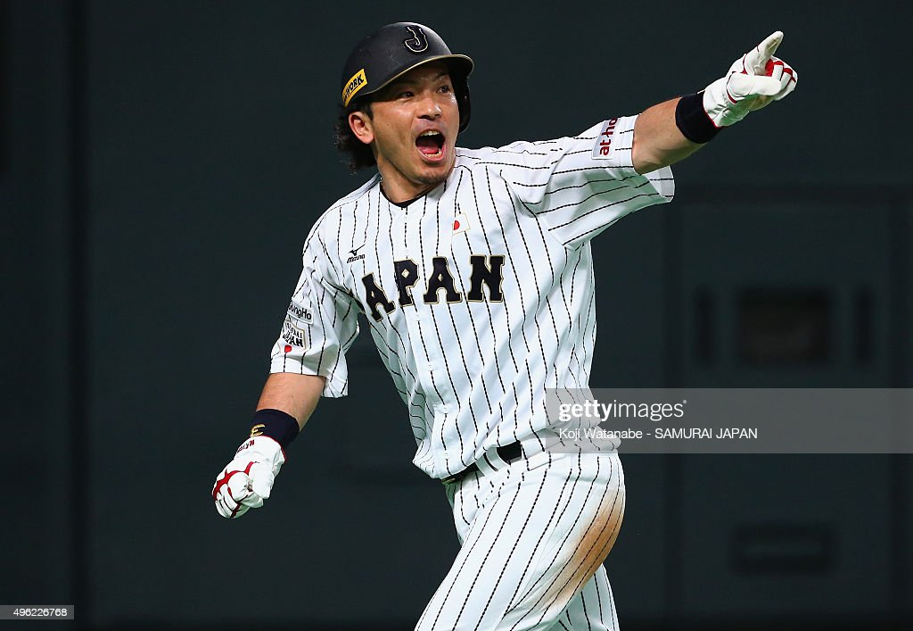 Nobuhiro Matsuda of Japan celebrates scoring by a sacrifice fly by Hayato Sakamoto in the bottom of second inning during the WBSC Premier 12 match...
