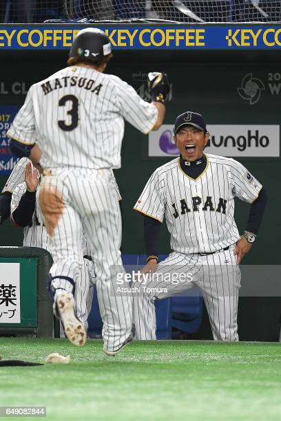 Nobuhiro Matsuda of Japan celebrates with manager Hiroki Kokubo after hitting a threerun homer in the fifth inning of the World Baseball Classic Pool...