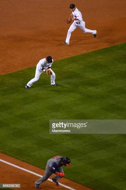 Nobuhiro Matsuda of Japan fielding error allowing United States scoring a run to make it 21 in the top of the eighth ininng during the Game 2 of the...