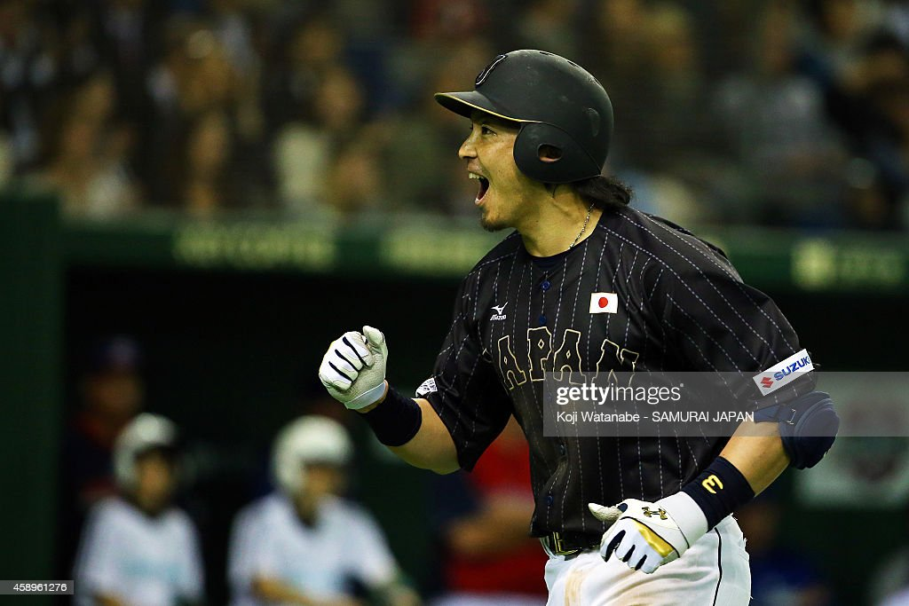 Nobuhiro Matsuda #3 of Samurai Japan celebrates after hitting a solo home run in the eighth inning during the game two of Samurai Japan and MLB All Stars at Tokyo Dome on November 14, 2014 in Tokyo, Japan.