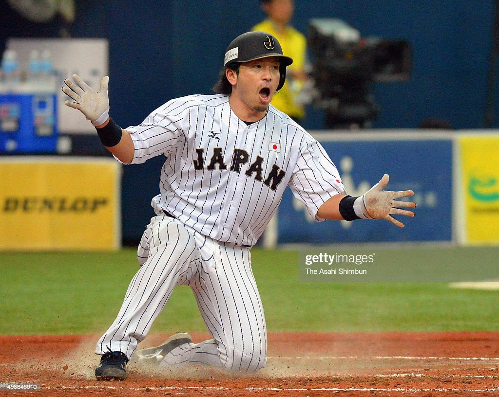 Nobuhiro Matsuda of Samurai Japan celebrates scoring after a RBI single by Tetsuto Yamada in the bottom of 4th innning during the Game one of Samurai...