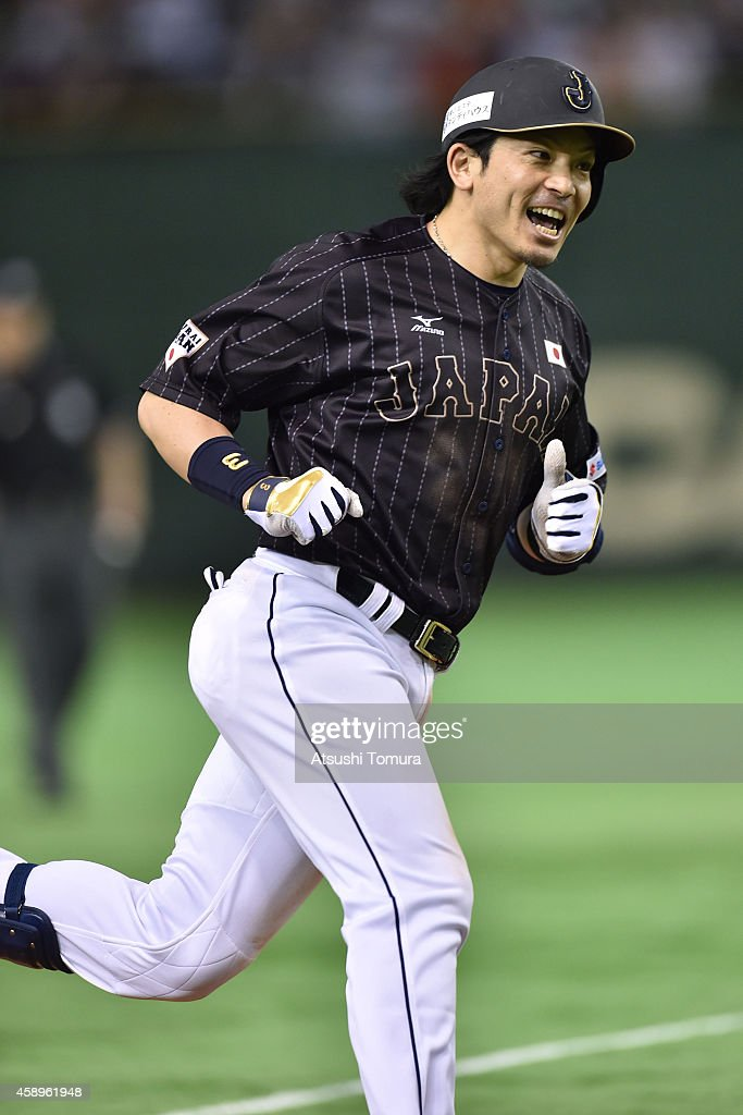 Nobuhiro Matsuda of Samurai Japan heads home after hitting a solo home run in the eighth inning during the game two of Samurai Japan and MLB All...