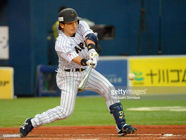Nobuhiro Matsuda of Samurai Japan hits a sacrifice fly in the bottom of 2nd inning during the Game one of Samurai Japan and MLB All Stars at Kyocera...