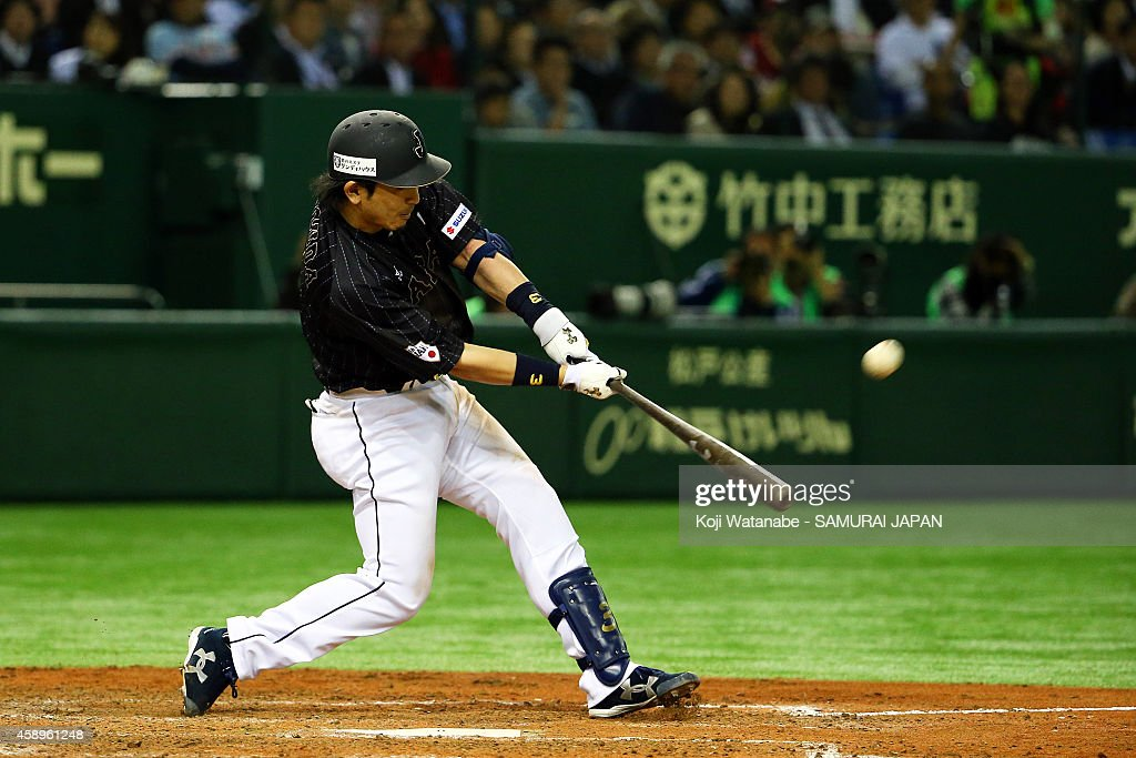 Nobuhiro Matsuda #3 of Samurai Japan hits a solo home run in the eighth inning during the game two of Samurai Japan and MLB All Stars at Tokyo Dome on November 14, 2014 in Tokyo, Japan.
