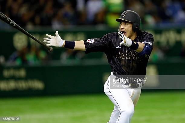 Nobuhiro Matsuda of Samurai Japan reacts to hitting a home run in the eighth inning during the game against the MLB AllStars at the Tokyo Dome during...