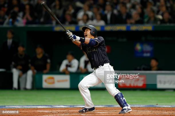 Nobuhiro Matsuda of Team Japan hits sacrifice fly in the fifth inning during Game 3 of Pool B against Team Australia at the Tokyo Dome on Wednesday...