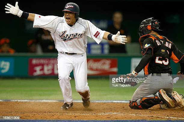 Nobuhiro Matsuda of Team Japan reacts after scoring in the eight inning during Pool 1 Game 6 between the Netherlands and Japan in the second round of...