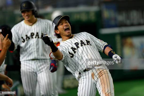 Nobuhiro Matsuda of Team Japan reacts to hitting a threerun home run in fifth inning during the Game 1 of Pool B against Team Cuba at the Tokyo Dome...