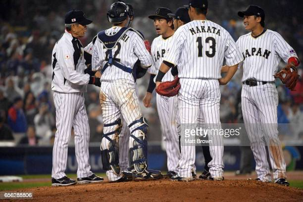 Nobuhiro Matsuda of Team Japan talks with teammates during a coaching visit to the mound during Game 2 of the Championship Round of the 2017 World...