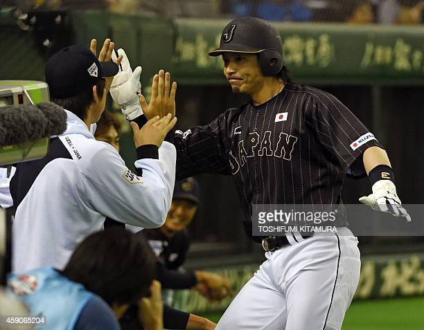 Nobuhiro Matuda of the Japan AllStars celebrates after scoring in the second inning during an exhibition game between the Major League Baseball...
