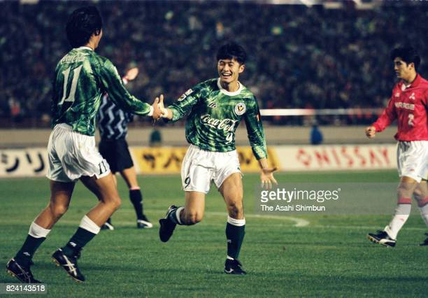 Nobuhiro Takeda of Verdy Kawasaki celebrates scoring his side's second goal with his team mate Keiji Ishizuka during the JLeague match between Verdy...