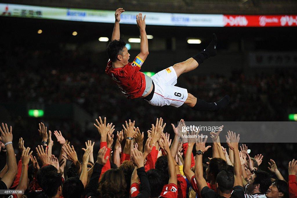 Nobuhisa Yamada is tossed into the air after the testimonial for Nobuhisa Yamada of Urawa Red Diamonds at Saitama Stadium on July 5, 2014 in Saitama, Japan.