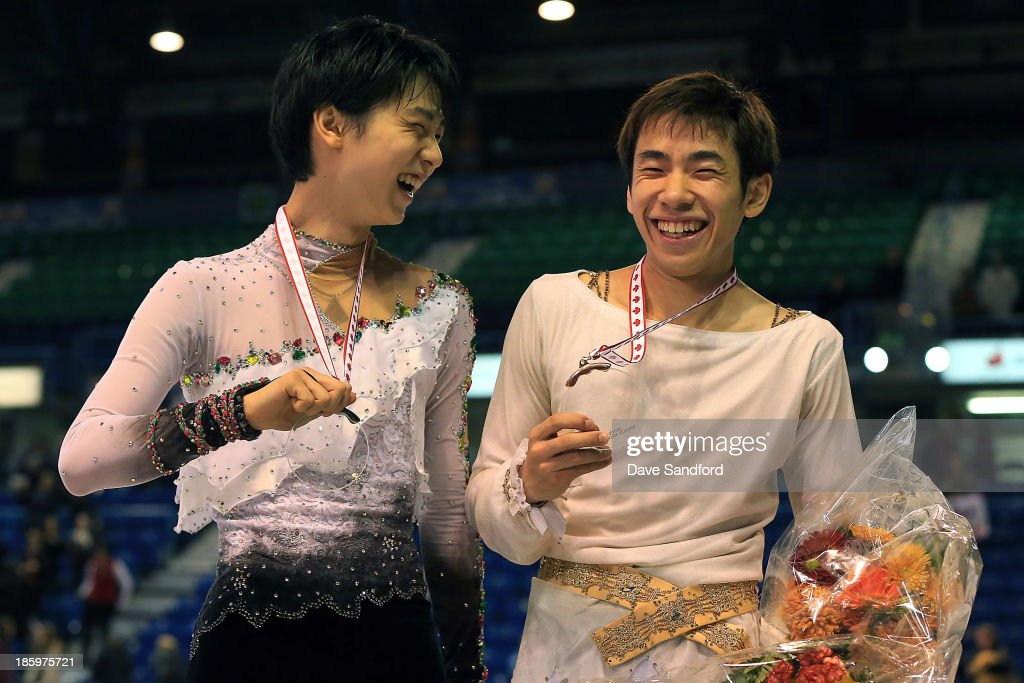 <a gi-track='captionPersonalityLinkClicked' href=/galleries/search?phrase=Nobunari+Oda+-+Figure+Skater&family=editorial&specificpeople=727292 ng-click='$event.stopPropagation()'>Nobunari Oda</a> (R) of Japan celebrates his bronze medal win with Yuzuru Hanyu of Japan who took the silver in the men's free program on day two at the ISU GP 2013 Skate Canada International at Harbour Station on October 26, 2013 in Saint John, New Brunswick, Canada.
