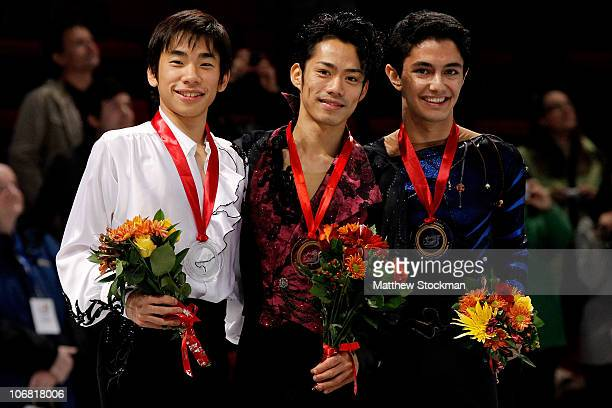Nobunari Oda of Japan Daisuke Takahashi of Japan ande Armin Mahbanoozadeh pose for photographers after the medal ceremony during Skate America at...
