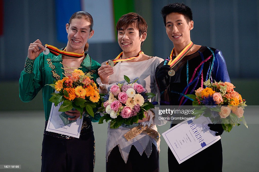 Nobunari Oda of Japan, Jason Brown of the United States and Jeremy Ten of Canada pose at the victory ceremony of the Men's competition during day three of the ISU Nebelhorn Trophy at Eissportzentrum Oberstdorf on September 28, 2013 in Oberstdorf, Germany.