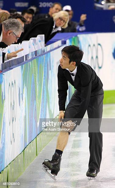 Nobunari Oda of Japan ties his lace while competing in the Figure Skating Men's Singles free program during day seven of the Vancouver 2010 Winter...