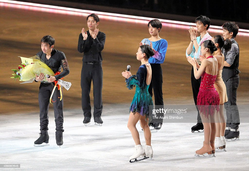 Nobunari Oda (1st L) receives a flower bunch during the gala exhibition as he announced the retirement during day four of the 82nd All Japan Figure Skating Championships at Saitama Super Arena on December 24, 2013 in Saitama, Japan.