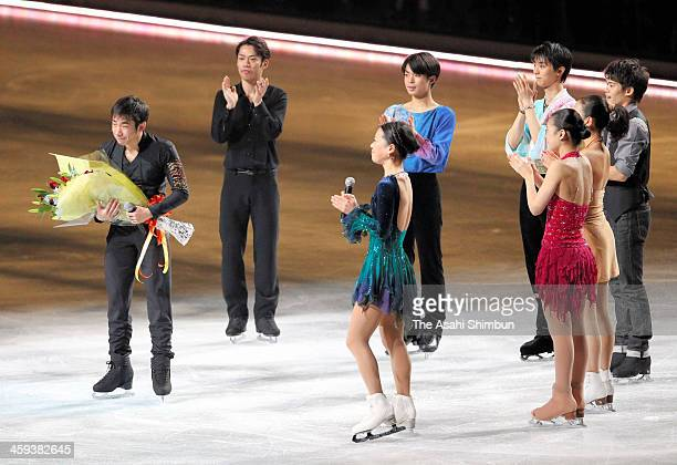 Nobunari Oda receives a flower bunch during the gala exhibition as he announced the retirement during day four of the 82nd All Japan Figure Skating...