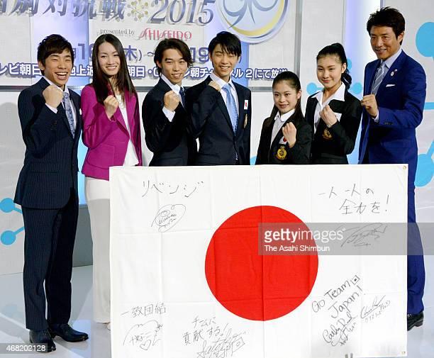 Nobunari Oda Shizuka Arakawa Takahito Mura Yuzuru Hanyu Satoko Miyahara Kanako Murakami and Shuzo Matsuoka pose for photographs during the Japan team...