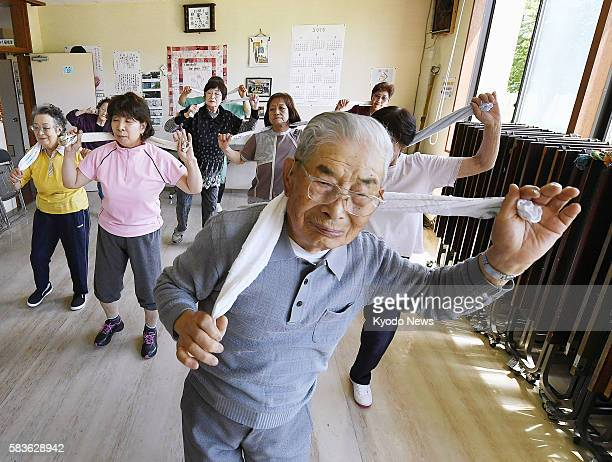 Nobuo Tabata a 99yearold resident of a failed northern Japan city of Yubari does exercises on June 29 2016 Tabata who worked at coal minerelated...