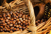 """""""Nocciola Piemonte Igp"""", also known as """"Tonda Gentile di Langa"""", hazelnut variety produced in piedmont (italy), with wicker basket and scoop"""