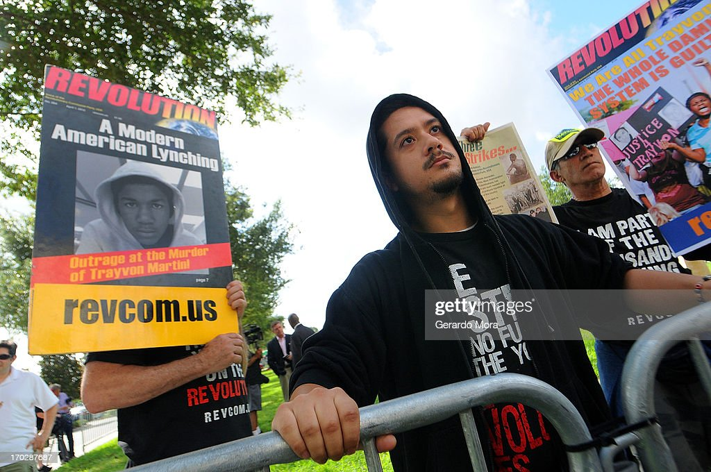 Noche Diaz (C) and members of the Revolutionary Communist Party hold signs in support of Trayvon Martin's family outside the Seminole County Courthouse during the first day of trail for George Zimmerman on June 10, 2013 in Sanford, Florida. Jury selection will begin today as Zimmerman is charged with the second-degree murder of an unarmed teenager, Trayvon Martin.