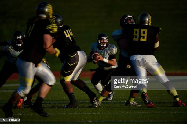NoCo Nightmare quarterback Matt Keeling looks for an open receiver as he is rushed by the Colorado Greyhawks defense during the second quarter at...