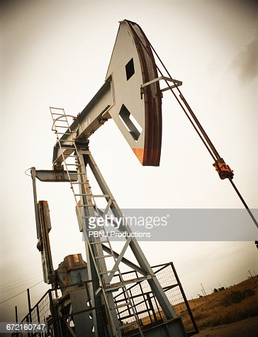 Nodding donkey oil rig : Stock Photo