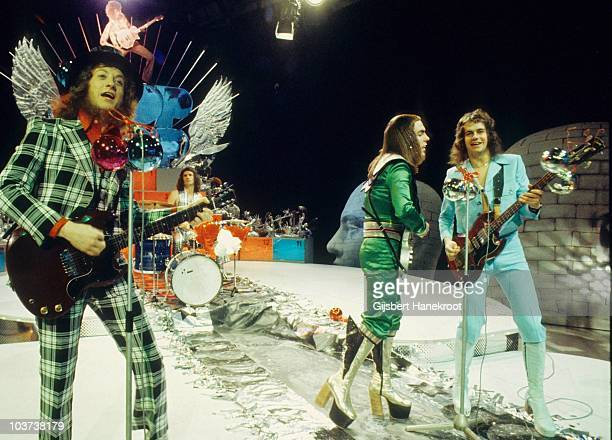 Noddy Holder Don Powell Dave Hill and Jim Lea of Slade perform on a Christmas TV show in December 1973 in Hilversum netherlands