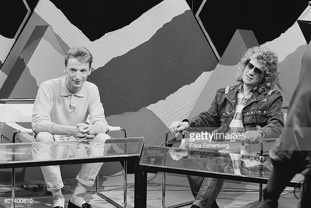 Noddy Holder of Slade and DJ and presenter Gary Crowley on the set of a TV show London 1980
