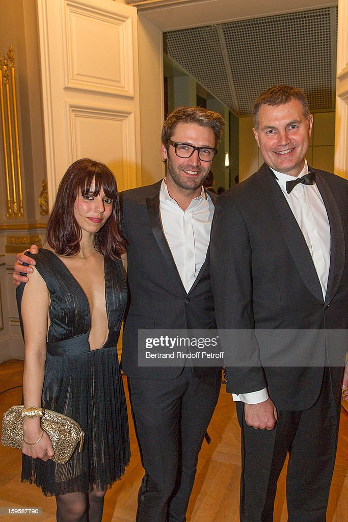 Noe Duchaufour-Lawrance (C), his wife Valentina Pilia (L) and Pierre de Saint-Albin, Press Officer, Air France, attend the GQ Men of the year awards 2012 at Musee d'Orsay on January 16, 2013 in Paris, France.