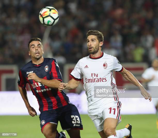 Noe Dussene of Crotone competes for the ball with Fabio Borini of Milan during the Serie A match between FC Crotone and AC Milan on August 20 2017 in...